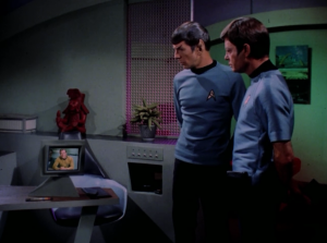 Bones and Spock start to fight, but then they watch a recording Kirk left them telling them to work together