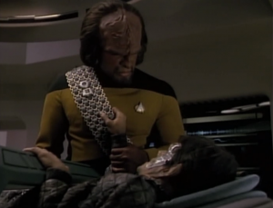 Only Worf can save the injured Romulan. He hates Romulans though