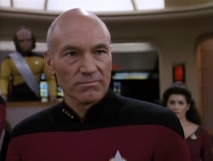 Picard has a cool confrontation with the Romulan warbird. At first he was really adamant that they not cross the neutral zone, and he wants to get to the bottom of why they were on the planet, but then he talks about being the first one to show a sign of trust
