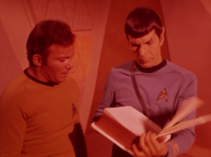 Kirk and Spock check out the book and the oracle tries to melt them