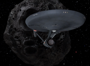 Enterprise comes across a ship that looks like an asteroid from the outside and from the inside people think they're on a planet
