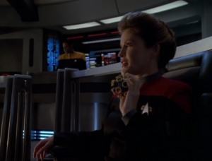 She even carries the ball with her to the bridge. Is this going to be like the Sisko/baseball thing for her?