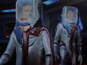 They beam aboard to see what happened wearing sparkly space suits