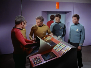 Scotty beams up the crew, but waits to rematerialize the Klingons