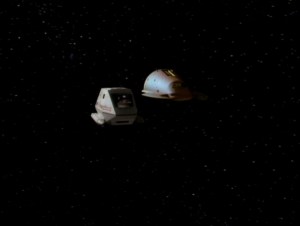 Enterprise and the ferengi ship send shuttles to check out the wornhole. It's not really that stable, and they end up in the Delta quadrant. The ferengi stay behind