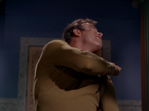 Kirk shows the leader some attitude and they make Kirk slap himself