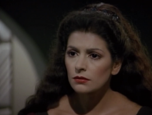 It seems like this would be an episode where Troi would be an enormous asset, but she just stares at the Romulan