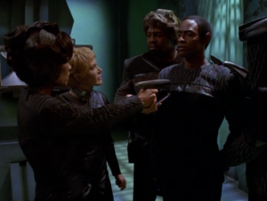 Tuvok tries to sneak in and attach something the Kes' face.