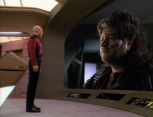 Picard arranges a meeting between the leaders of the two groups. Hey how comes when we're looking at the view-screen from the right side, we can see the guy's profile? ...