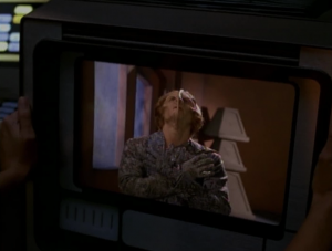 The aliens from the beginning of the episode show up again. They're going to destroy Voyager because they want to destroy the virus. Didn't really need the extra stakes that we don't buy, and we didn't really need to see this weirdo again