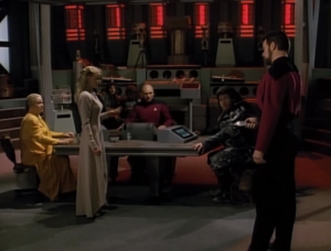 Riker beams in to stop her plot of killing the other group's leader