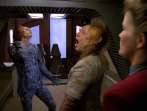 There's a species that speaks with body language, and were offended by Janeway putting her hands on her hips
