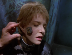 But then Voyager leads an assault and manages to attach a thing to her face