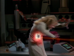 She tries to touch the guy so Riker shoots her a few times. She won't stop so he vaporizes her. It seems like there had to of been some way to stop her without vaporizing her
