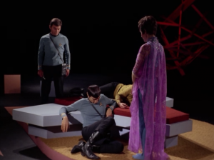 My favorite part of the episode is when one of them must go to be tortured and Bones knocks Kirk and Spock out with hypos