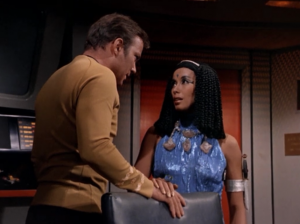But then Kirk notices Elaan's necklace has some dilithium crystals. Also, why did they need to make four different needlessly sparkly and revealing outfits for Elaan? Couldn't they have just made her one outfit, and spent the money on a new Romulan ship or something?