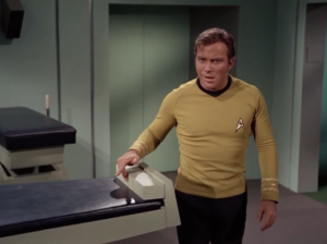 When they get back to the ship Kirk thinks something is touching him and he keeps hearing a bug noise