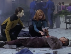 Crusher witnesses and explosion that injures 3 people. Data and Worf tell her the area isn't safe. Picard wants to beam them up, but Crusher won't leave them. Why not just beam up the landing party and the 3 injured people?