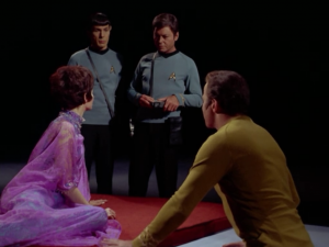 Spock, Bones and Kirk find themselves in a big dark room with a lady that can't speak