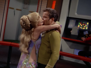 A lady shows up and kisses Kirk