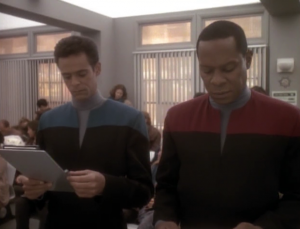 Bashir and Sisko have to fill out paper work and wait in lines