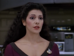 Troi tries to talk to him. We later find out that he has a very sympathetic position but he doesn't initially tell Troi about it cause he hates counselors