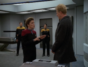 Janeway transports the evil rich man to the ship and threatens to get his time ship. He says it's rigged to explode and will destroy LA. I don't understand this guy