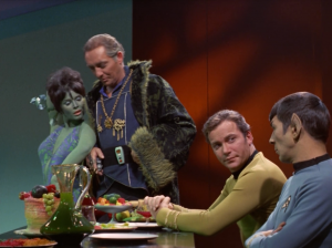 He tries to get the Orion lady to seduce Kirk with her dancing