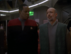 At the end this guy warns Sisko that the emissary will face a fiery trial!