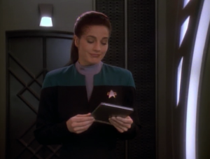 Two Cardassians are expected at the station to help do a science project with the wormhole