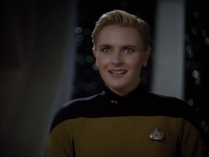 Yar gets funny looks from Guinan. Guinan tells her that she's supposed to have died in some meaningless way