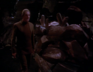 Odo figures out that the phaser marks don't quite line up in Kira's story. He's also suspicious about Kira saying that she loves him back