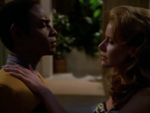 Tuvok stays late, talking with the holodeck lady. There starts to be shoulder-touching, so Tuvok gets the heck out of there