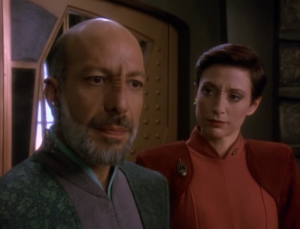 A bajoran guy warns Sisko about a prophecy about three snakes and a sword of stars. He thinks the Cardassians are the snakes