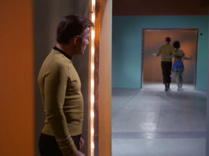 He locks up Kirk and changes to look like him. He wants to take control of Enterprise