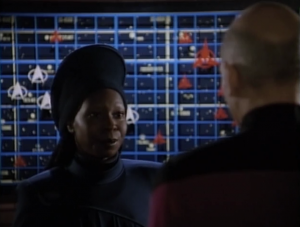 Guinan says they have to send the ship back through the portal, even though they will die. They were paramount in the peace treaty between the Klingons and the Federation