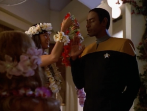 Tuvok goes to the luau also, and sees the holodeck lady playing his favorite Vulcan game. Weird