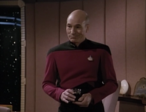 The mean Starfleet guy comes aboard Enterprise and argues with Picard