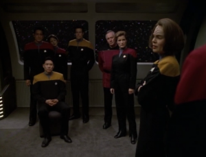 They hold a memorial for Janeway. They only brought enough chairs for Harry