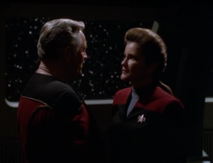 It's actually an alien trying t lure Janeway into some portal, btu he can't just take her there, so she has to convince her that she was dead, and have her go willingly. So as I mentioned before, the segments about Janeway dying in different ways makes no sense.