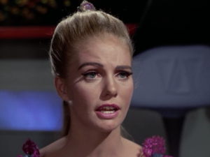 Whenever Kirk asks about the planet he was beaming to, or anything else about what's going on, this lady has no idea what he's talking about