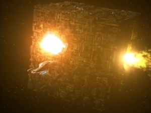 Somehow the former Borg on the planet make it so the Borg cube self-destructs