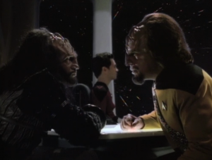 If the challenge is rejected, Worf has to face punishment for his father (death of course). He thinks it would be a good idea if his little brother hide his relation