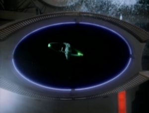 It was a cloaked Romulan Warbird! It's actually kind of lame that one Warbird could take out DS9