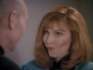 The duplicate Picard asks Beverly to dinner