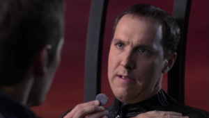 He asks Archer not to kill himself, and that  he has to convince the Xindi to be friends. He gives Archer a Xindi medallion that can be quantum-dated as being from the future
