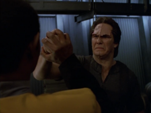 A guy tries to punch Tuvok