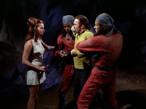 When she takes Kirk to the mines she decides she'd rather kidnap him
