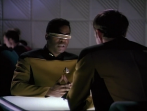 """Geordi finds out about his holodeck adventures. Sometimes I think this whole episode is so we see Geordi in a different light, and that he looks less dorky by comparison. It is kind of weird seeing him as the tough-boss-type, although it works. I guess that's the power of a """"lower decks"""" type of episode."""