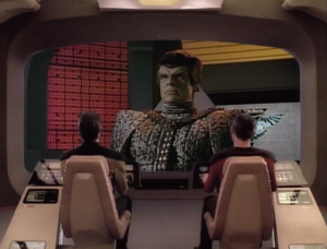 More Romulans show up. They seek the right of vengeance against the alien